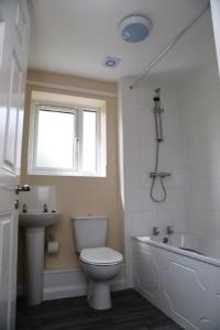 bathroon with sink, toilet, shower and bath