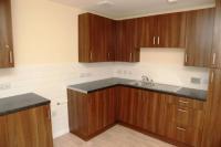 Kitchen with brown worktops