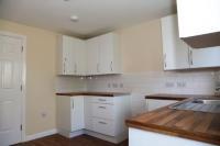 Kitchen with white worktops
