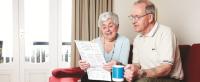 image of couple reading bills